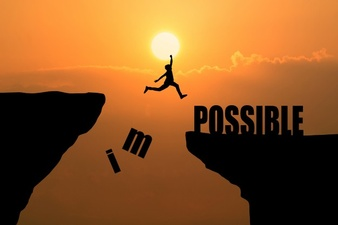man-jumping-over-impossible-or-possible-over-cliff-on-sunset-background-business-concept-idea_1323-266